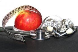 Una manzana con un metro